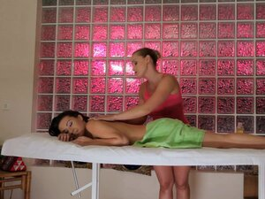 Pretty chicks get naughty in a massage session