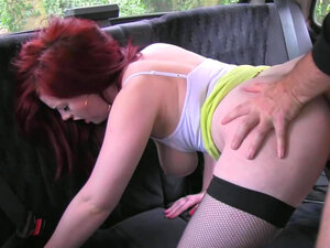 Slender redhead babe bangs with a taxi driver