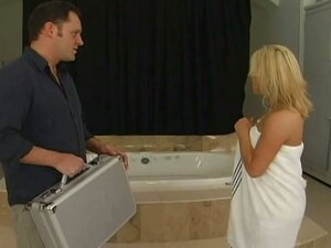 Blonde milf gets repair job in the bathroom