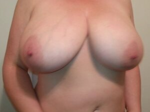 Mature lady shakes her big boobs infront of the mirror