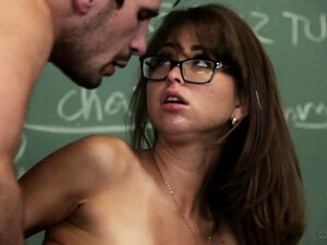 Slutty schoolgirl gives her teacher a blowjob on top of his desk