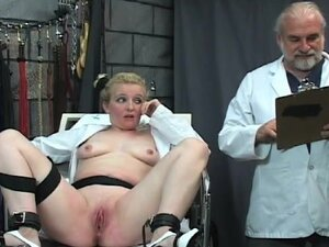 Doctor experiments on BDSM girl in dungeon