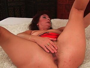 Busty senior lady rubs her hairy cunt and fucks.