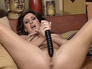 Milf Emilianna toying with huge black dildo in her pussy and between the tits