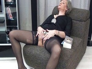 Mature housewife in sexy black stockings