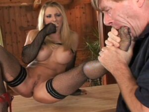 Leggy chick is wanking this hard dick with her legs