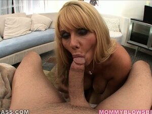 Voluptuous blonde cougar with huge boobs reveals her passion for sucking big cock