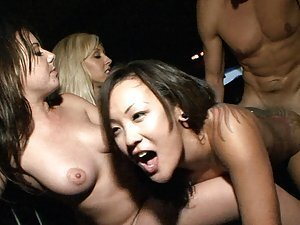 A bunch of randy college chicks go to a club, get naked and fuck random different dicks
