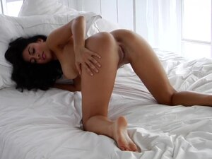 Solo brunette in her bed