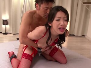 Hitomi Honjou in red stockings and lingerie gets fucked hard by two men