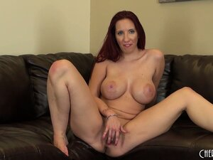 Busty Kelly sits on the couch fingering and then does some more poses