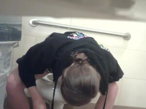 Girl pissing and stretching legs not to touch dirty bowl