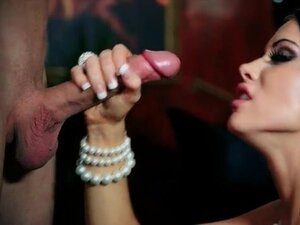 Skinny beauty in pearl necklace and stockings sucks cock
