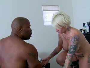 Short haired blonde is giving blowjob