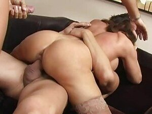 Naughty brunette busty milf getting gangbanged by two huge cocks