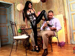 New years is celebrated by brunette babe in latex giving a footjob