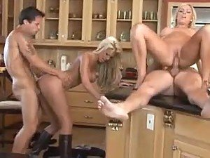 Couples wife swapping in the kitchen
