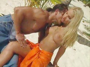Perfect blonde is fucked on the beach
