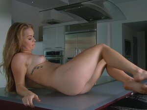 Madison Chandler lying on the table and showing herself