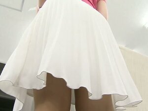 Cute Asian cleaning lady lets us peek up her skirt