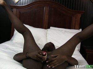 Ebony gal spreads wide to shove her vibrating toy into her cunt