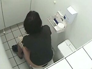 A pissing girl is exposed to a toilet voyeur cam