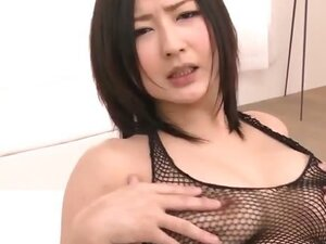 Fishnet clad Megumi Haruka  rips her nets apart to finger her pretty shaved pussy before sucking a hard cock