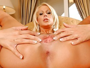 Dorina claims the best way to reach an orgasm is to finger her wet, pliant pussy... How many digits can this blonde babe insert? Check it out yourself!