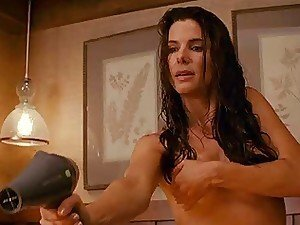 A hot little piece of video as Sandra Bullock cups her impressive titties