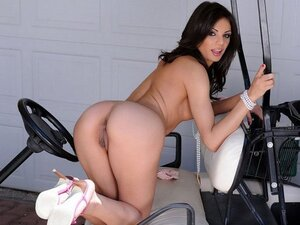 While this brunette beauty's fella plays golf she gets naked on a golf cart and pussy plays