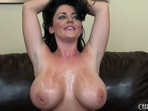 Sophie is all oiled up and shows her big hooters and trimmed slit