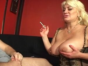 Huge racked blonde mature lingerie slut sucks cock and smokes cigarette