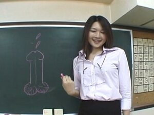 Japanese girl draws cock on chalkboard and jerks cock
