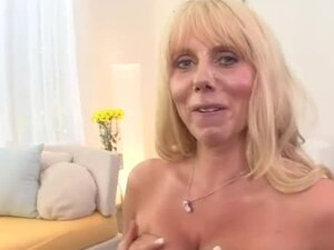 Mature blonde with massive jugs gives sensual blowjob