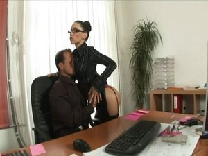 Naughty, nerdy brunette secretary in sexy black stockings gets drilled by the boss
