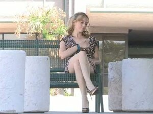 Maelynn is fingering her pussy sitting on the bench