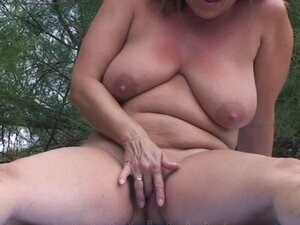Tasty mature plays and masturbates pussy outdoors. Reality