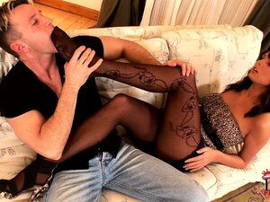 Brunette with nice long legs milks a cock with her pretty feet