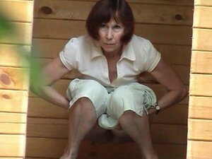 Mature woman is peeing in a reality video