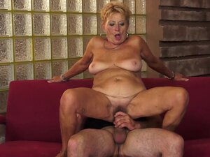 Granny with a hairy pussy fucks on top like nuts