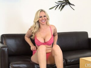 Astonishing blonde Julia Ann shows off her wonderful body on a black couch