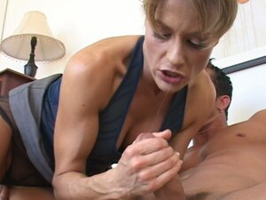 Horny mom Saskia is interested in the young guy in towel