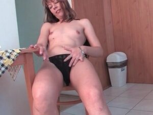 Housewife strips as she cleans her house