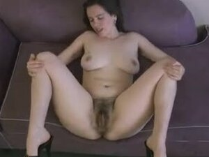 Kinky dark-haired girl shows off her ugly hairy snatch