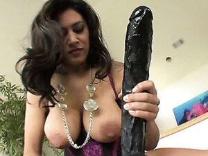 Raylene is a sexy and busty MILF. Watch her take out her favorite toy and go to work.