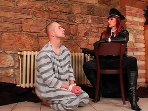 Dominant redhead abuses a male prisoner