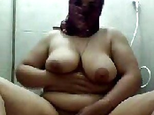 A mature Persian fatty likes to get naked on her own and masturbate on camera