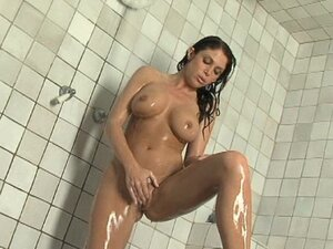 Busty brunette Jessica DiFeo is getting wet under the shower