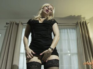 Sexy blonde shows off her chastity belt and her ass as she poses