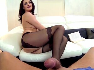 Leggy gal Carla Mai stays in stockings only before starting to give nice footjob to her boyfriend. She takes stockings off after that and continues footjob without them.